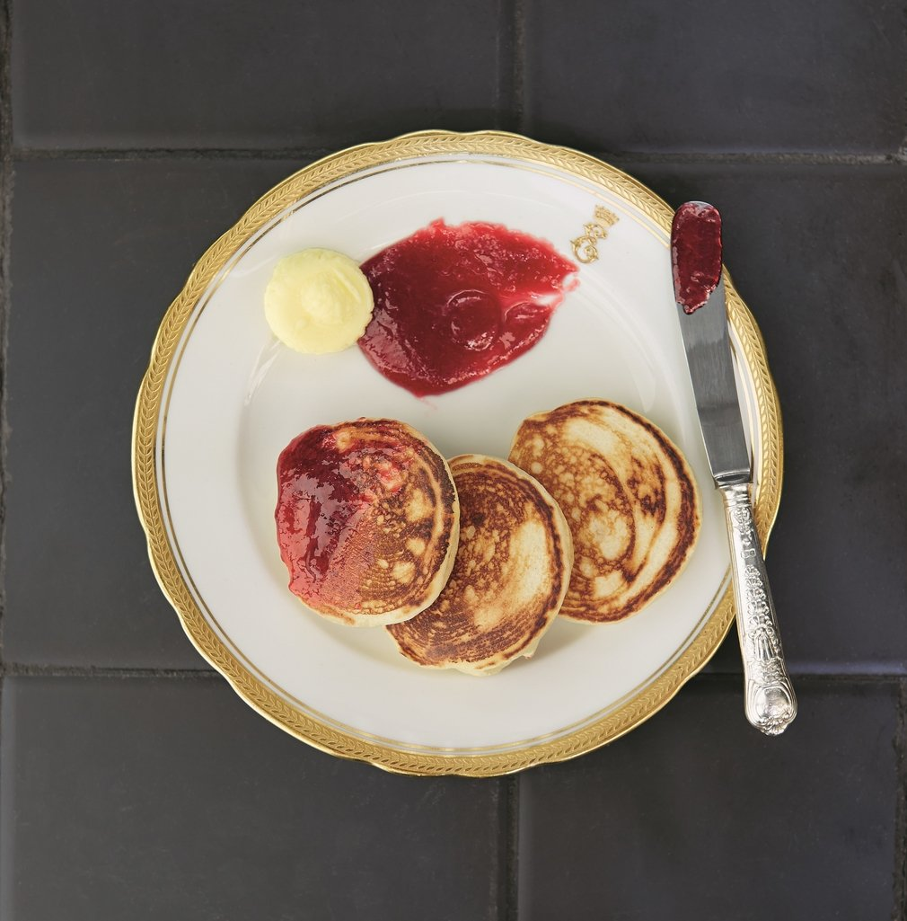 Drop Scone with jam on yellow plate