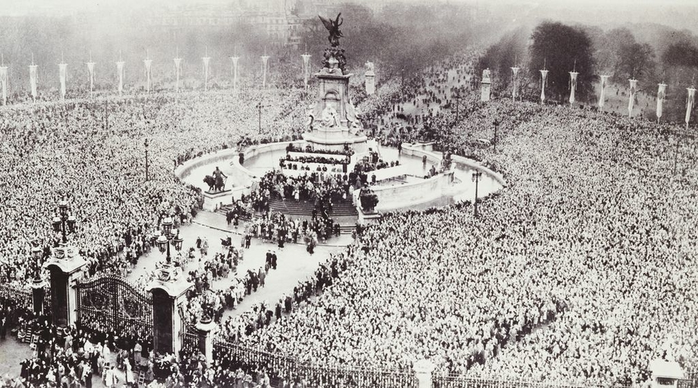 An aerial photograph of the scene outside Buckingham Palace on the wedding day of Princess Elizabeth and the Duke of Edinburgh. Huge crowds all around the Queen Victoria Memorial and up the Mall.