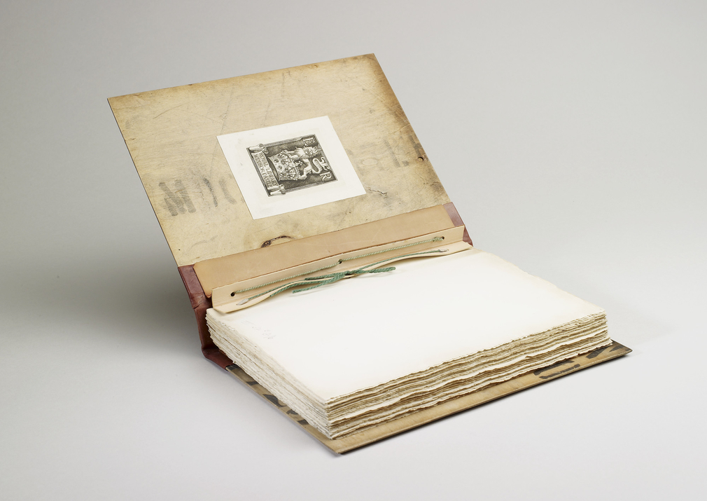 Bound in Venesta packing case boards, rebacked in quarter leather cow with original cowhide spine inset