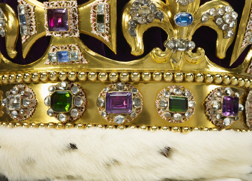 The crown is composed of a solid gold frame, set with tourmalines, white and yellow topazes, rubies, amethysts, sapphires, garnet, peridot, zircons, spinel, and aquamarines, step-cut and rose-cut and mounted in enamelled gold collets, and with a velvet ca