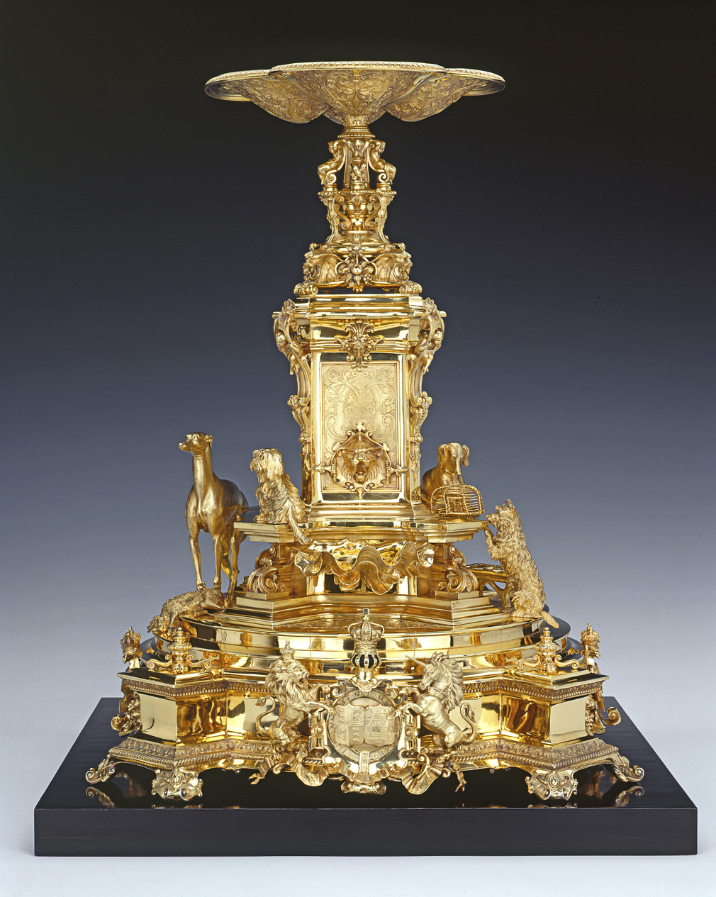 Prince Albert's close interest in design led to first-hand participation on several occasions. This centrepiece was his first collaboration with the firm of Garrards, and it seems that the combination of an Italian Renaissance-style tazza and models of fo