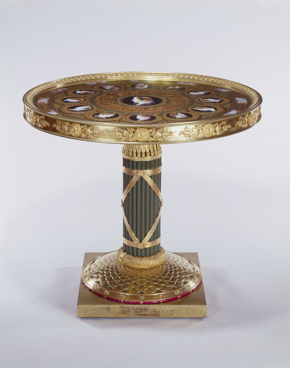 Centre table with circular Sèvres porcelain top with chased gilt bronze mounts, stem-fasces; painted in imitation of classical cameos. In the centre is the head of Alexander the Great, surrounded by an outer circle of heads of twelve commanders fro