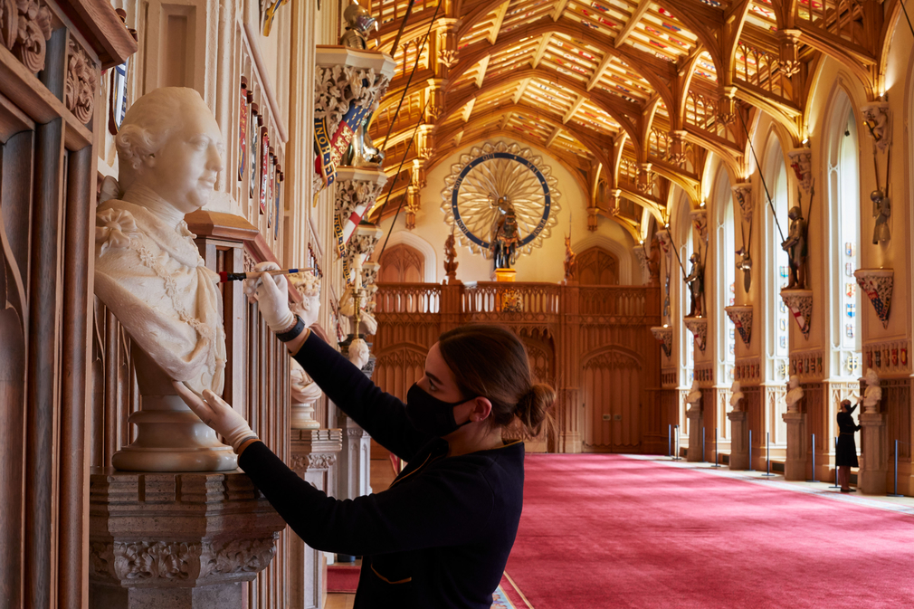 A member of staff dusts a marble bust in St George's Hall, the largest room in Windsor Castle