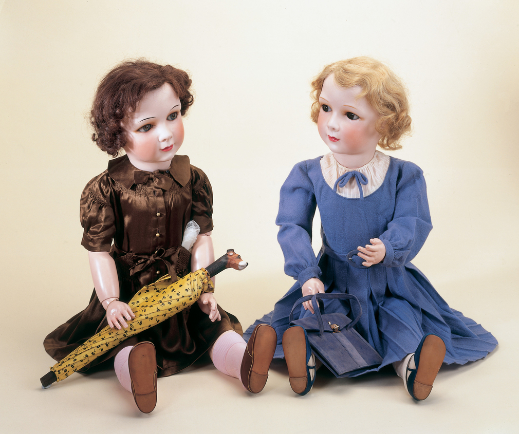 A Jumeau fashion doll, <em>France,</em> with porcelain face and jointed limbs, fixed, fair hair and moveable brown eyes, painted lips, eyebrows and pierced ears. With gold identity bracelet with French flag in enamel and stamped 'France'.<br> <br>This dol
