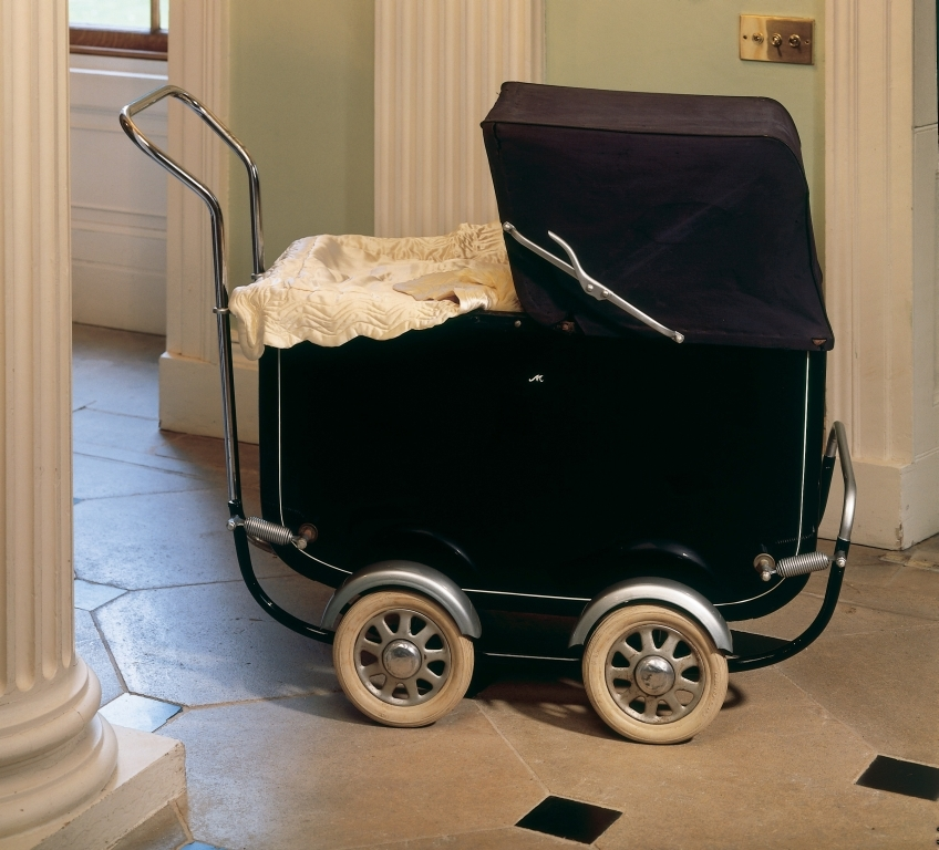 A blue painted child's perambulator with white rubberised interior and white rubber wheels with chrome plated guards.