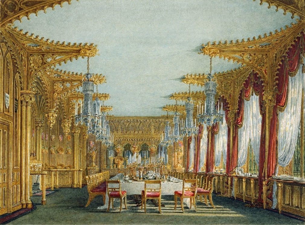A watercolour depicting the Gothic Dining Room at Carlton House, featuring marvellous gothic panelling and finial vaults and carving. Windows are framed by red curtains to the left, a large long table with red covered chairs is arranged in the middle of t