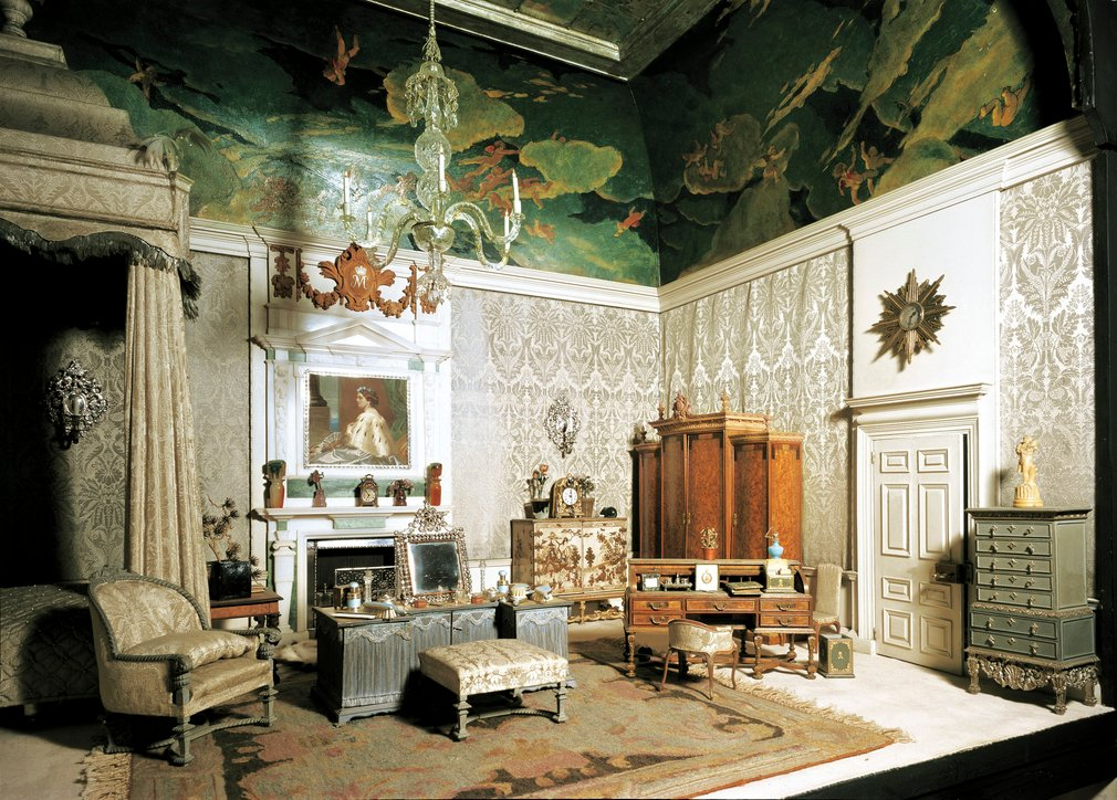 Queen Mary's Dolls' House was created as a 1:12 scale miniature royal palace or town house as a gift from the nation to Queen Mary. The House, with a façade in the style of Sir Christopher Wren or Inigo Jones, is operated by a mechanism in the base