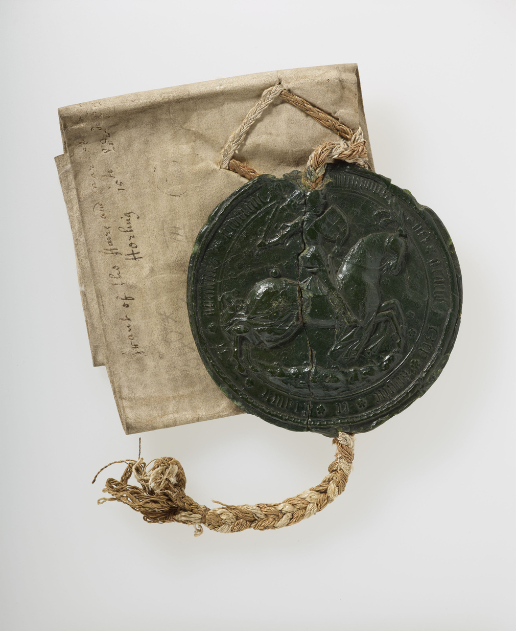 A vellum deed with black wax seal attached.Obverse of seal with enthroned Edward III, flanked by Royal coat of arms (England & France quartered); reverse with Edward III in armour, on horseback. Trellis decoration of flowers behind. Seal on a plaited silk