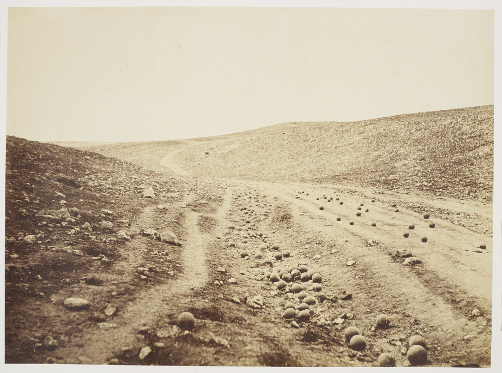 Photograph of a ravine in the Crimea known as the Valley of the Shadow of Death. The ravine is littered with cannonballs fired from the Russian defences. This iconic image of war was photographed by Fenton in April 1855. The ravine, named by British s
