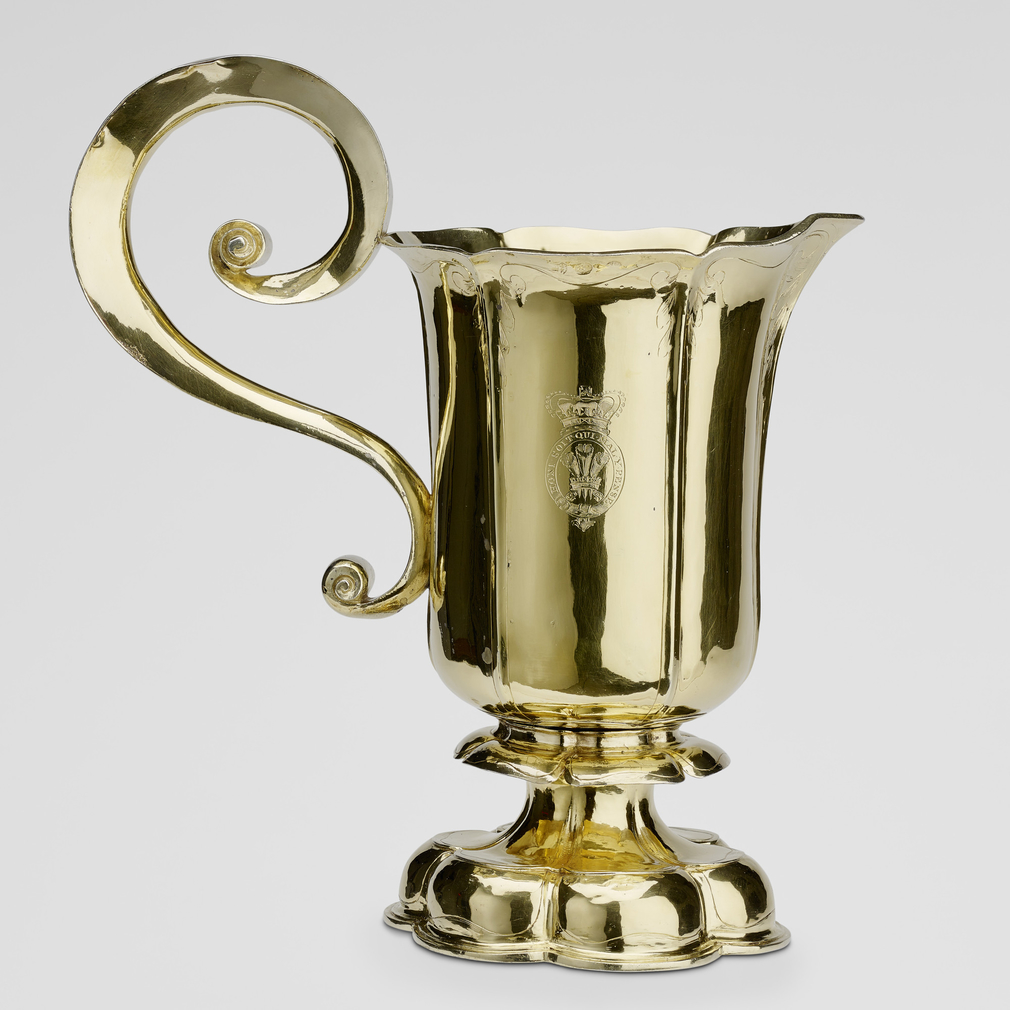 This ewer, and its associated basin, belonged to the 'Winter Queen', Elizabeth of Bohemia (1596-1662), whose arms are engraved in the centre of the basin. Elizabeth, daughter of James VI and I and grandmother of George I, linked the Stuart and Hanoverian