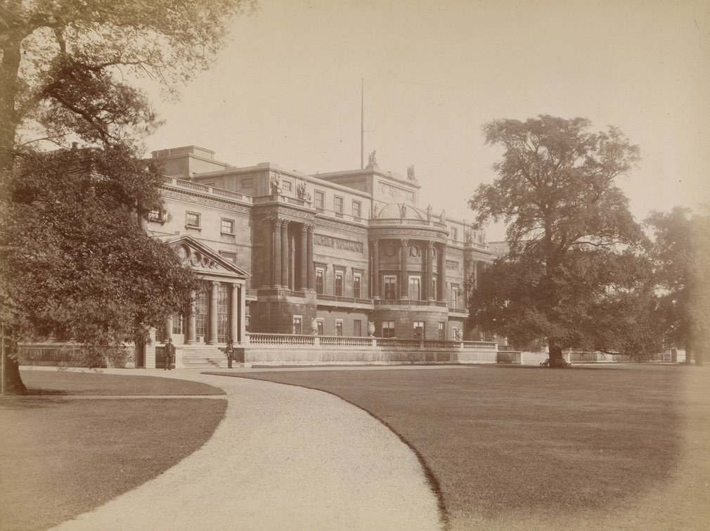 Photograph of the Garden Front at Buckingham Palace with the west facing Palace facade with trees either side