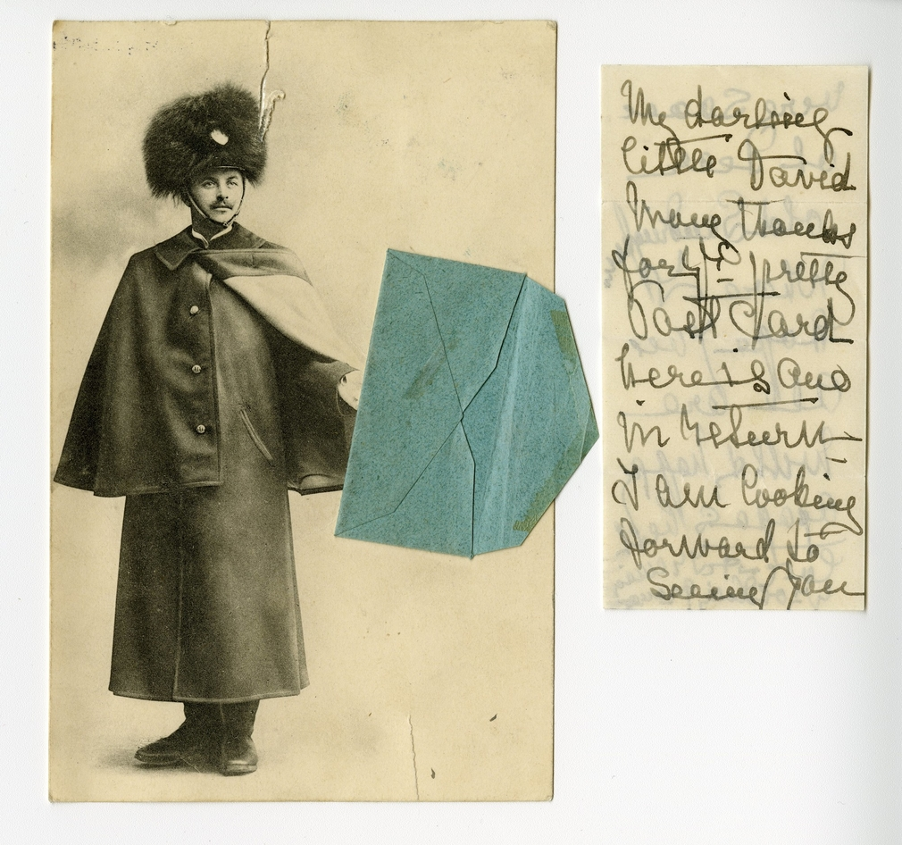 Postcard of a soldier, holding a small blue envelope. The card was sent to Prince Edward of Wales, later King Edward VIII, by his grandmother Queen Alexandra.There is a note folded into the envelope which reads: 'My darling little David. Many thanks for y