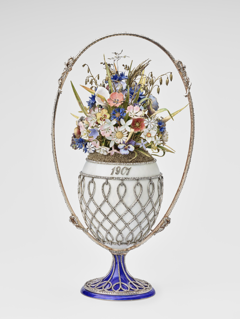 Imperial Easter egg, basket-shaped, silver-gilt and oyster guilloché enamel mounted with rose diamond trellis and oval handle with four bows, blue enamel splayed base with rose diamond trellis. Egg contains wild flowers, leaves and husks of enamel