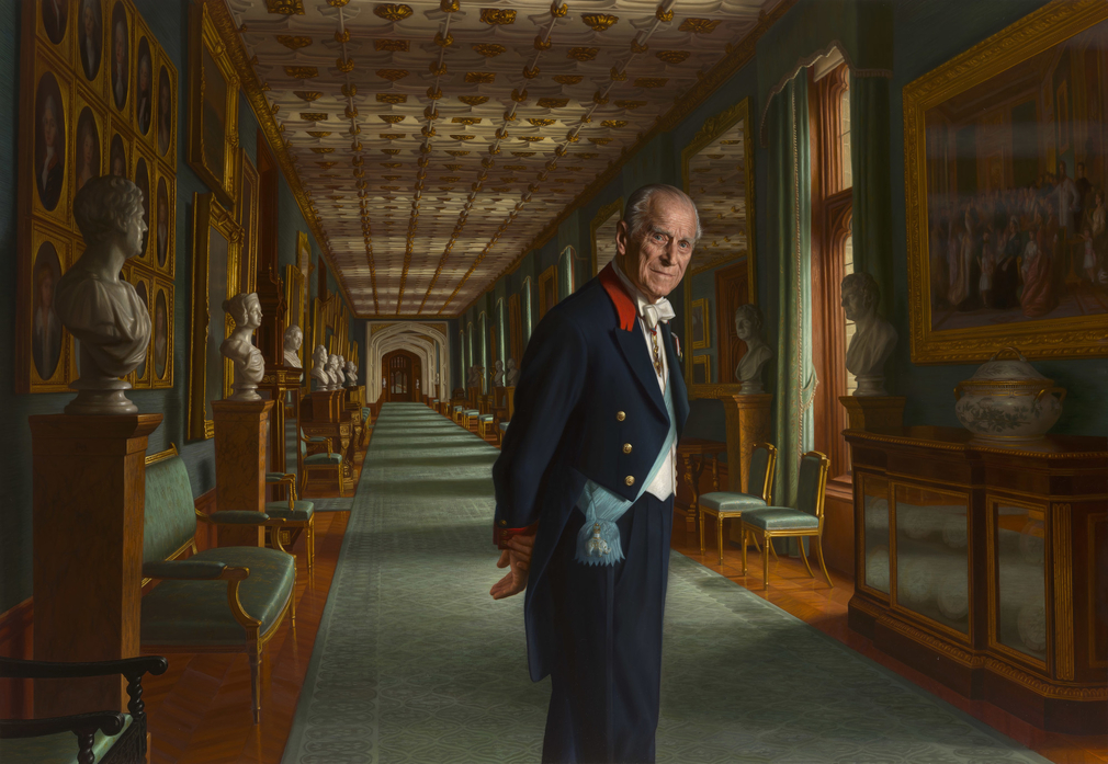 A three-quarter-length portrait of the Duke of Edinburgh, standing facing half to the right, his head turned to the front, with his hands clasped behind his back; wearing Windsor Uniform with the pale blue sash of the order of the Elephant. He is standing