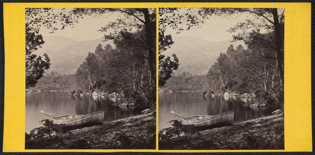 Stereoscopic photographof a rowing boat moored at the side of Loch Katrine with trees in the foreground framing a view towards hills in the distance.  Sir Walter Scott immortalisedLoch Katrine and the Trossachsin the Scottish Highlands b