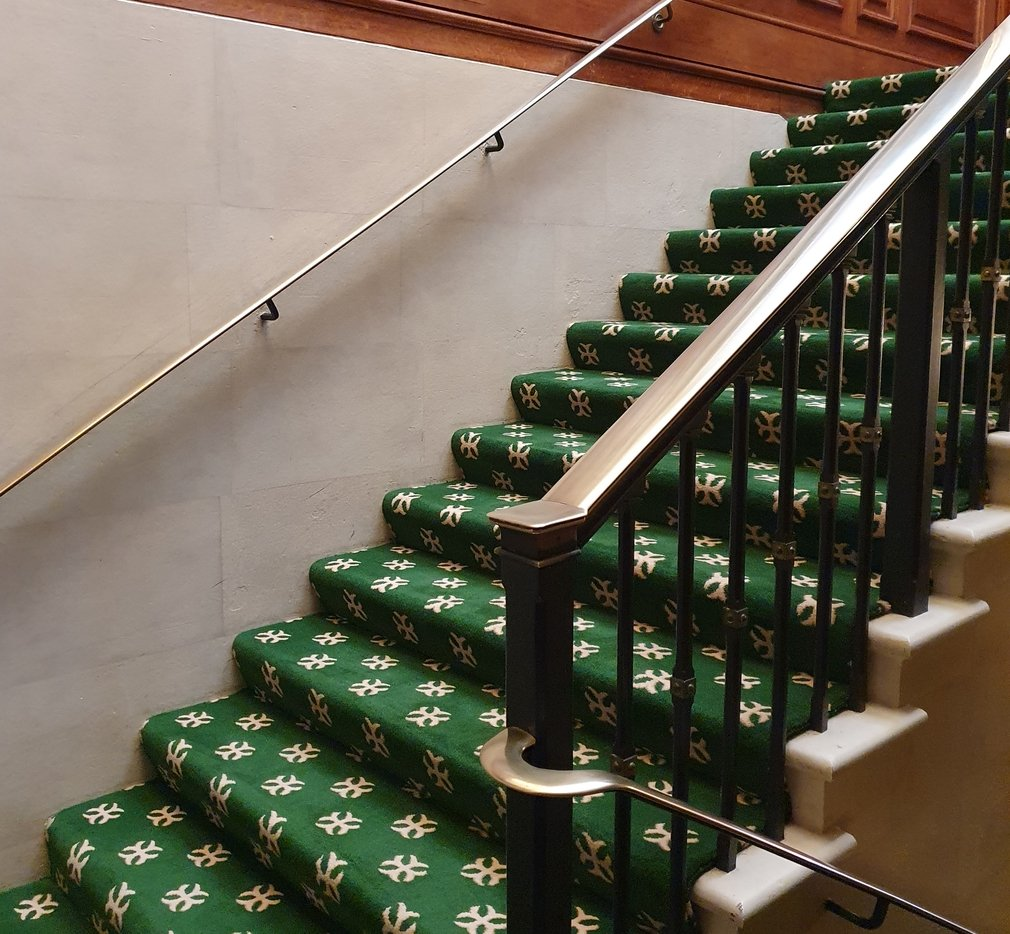 Green patterned carpet on the Armoury Staircase