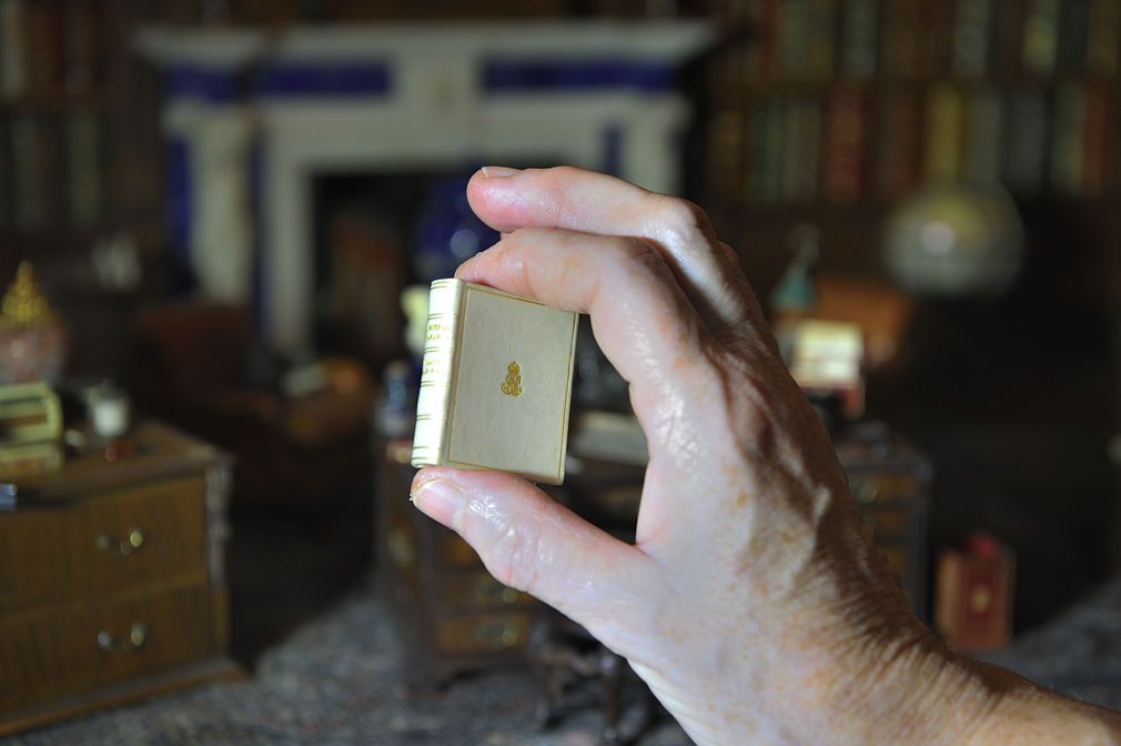 The original miniature copy of A Note of Explanation by Vita Sackville-West in the library of Queen Mary's Dolls' House at Windsor Castle.