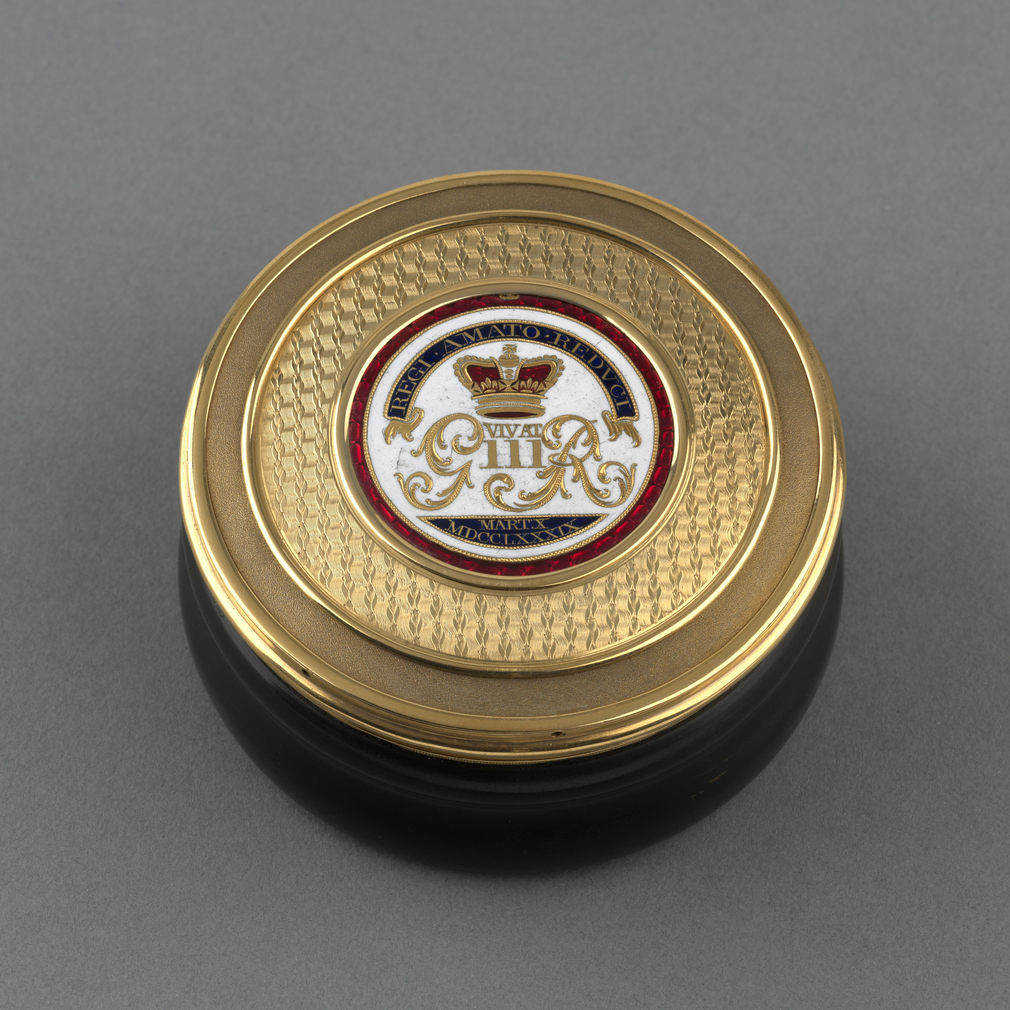 Circular tortoiseshell box with gold cover inset with central white, red and blue enamelled disc with crowned GIIIR cypher