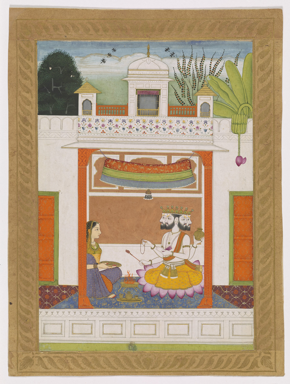a lady performs a worship ritual before a figure of Brahma