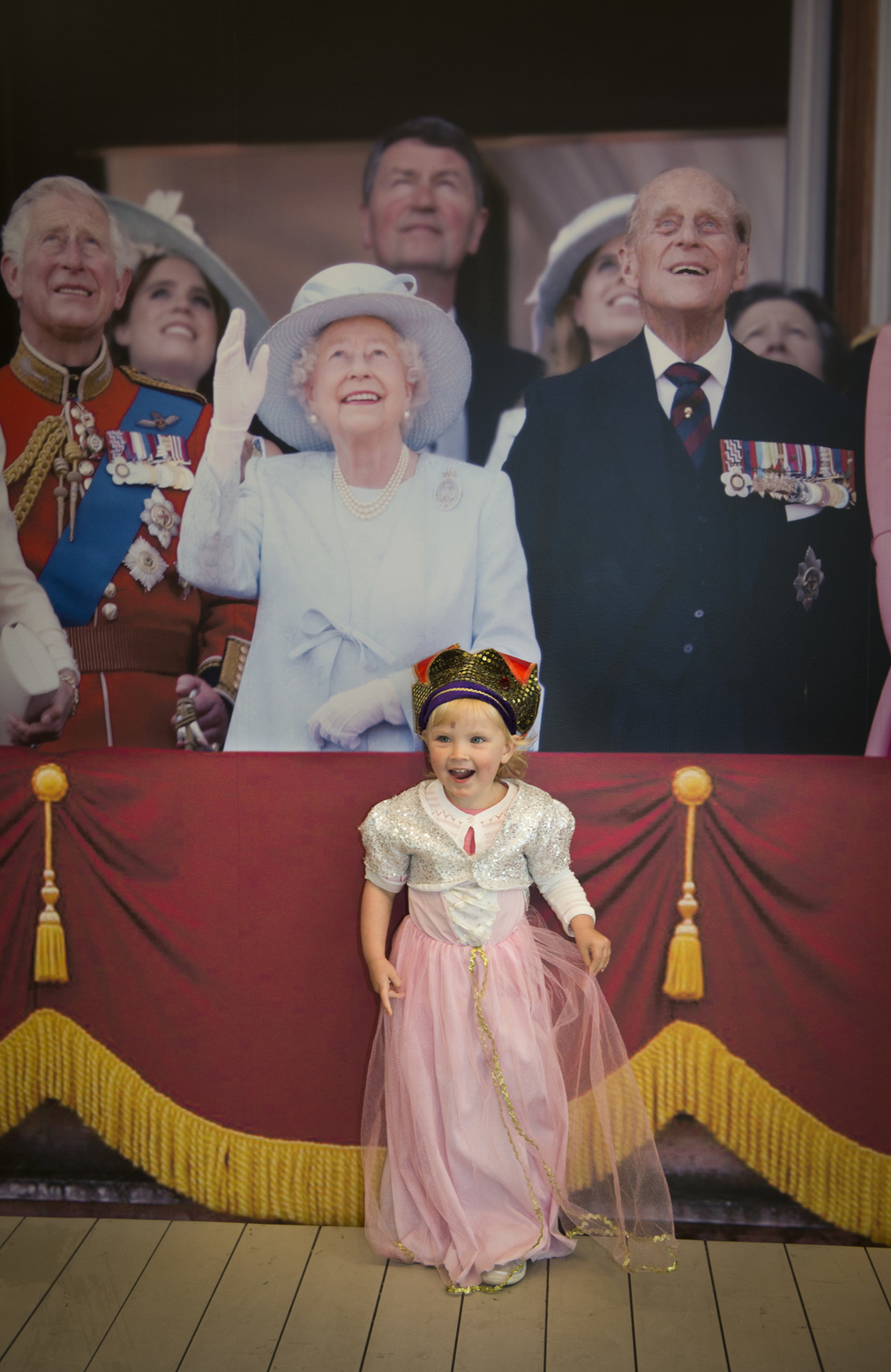 Child dressed as a princess at Buckingham Palace