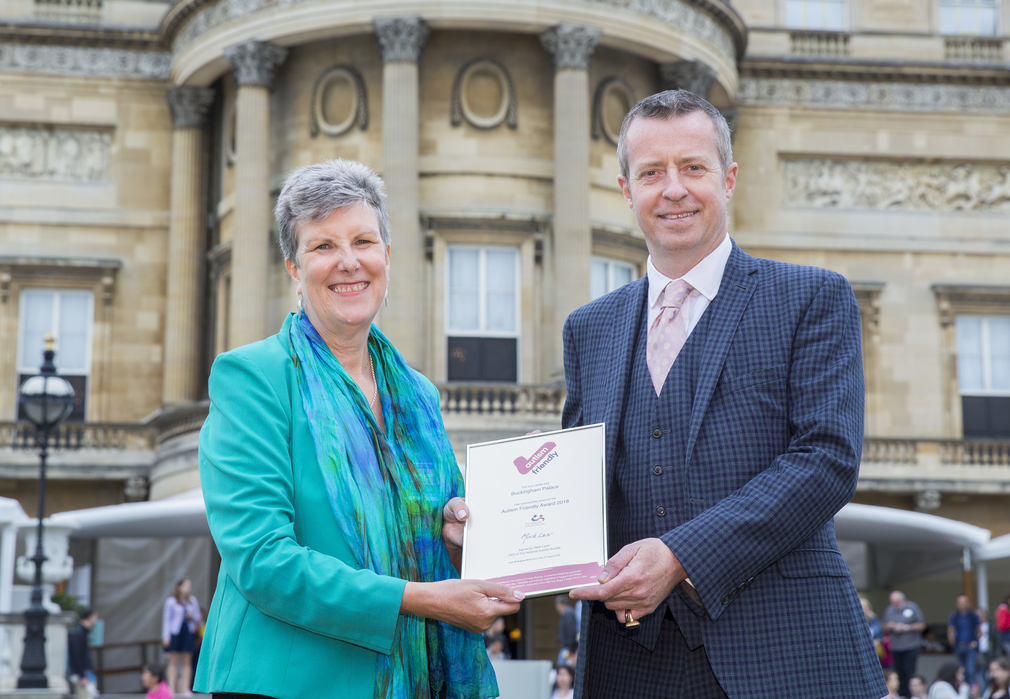 Tim Knox, Director of the Royal Collection, is presented with an Autism Friendly Award by Carol Povey, Director of The Centre for Autism