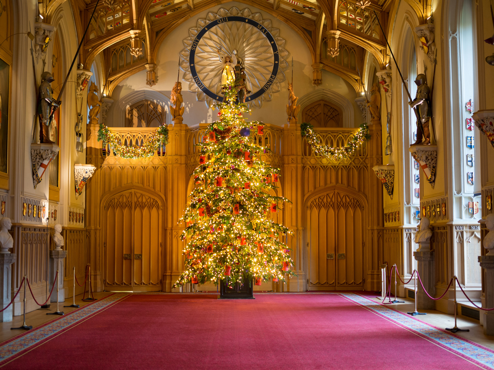 Christmas Tree illuminated with lights in St George's Hall at Windsor Castle