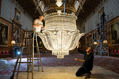Chandelier being cleaned at Windsor Castle
