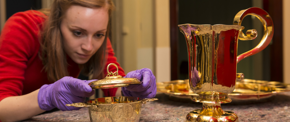 Siobhan assists with the installation of an exhibition at The Queen's Gallery, Buckingham Palace.