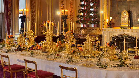 The dining table in the State Dining Room displayed with silver-gilt from the Grand Service