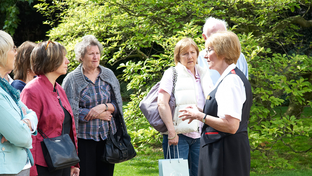 A warden with a group in the garden at Clarence House
