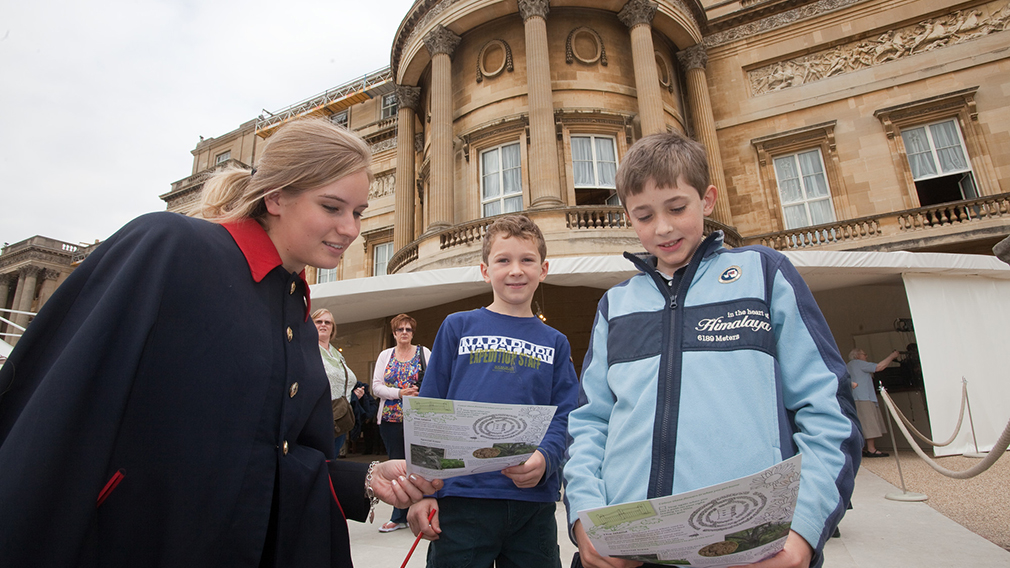 Children with a warden at Buckingham Palace