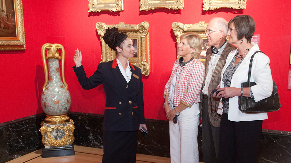 Warden with visitors to The Queen's Gallery, Buckingham Palace