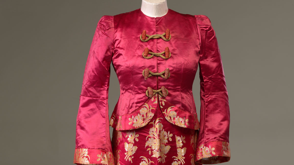 Crimson jacket and matching sleeveless long silk dress worn by  Princess Margaret as 'Princess Roxana' in the 1943 production of Aladdin at Windsor Castle.