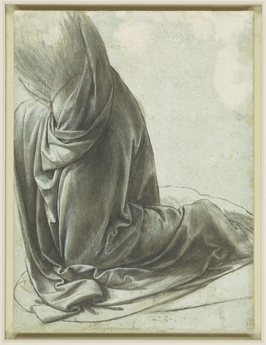 The drapery of a kneeling figure