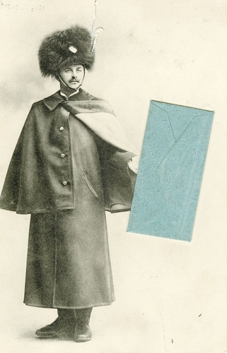 Postcard of a soldier holding an envelope