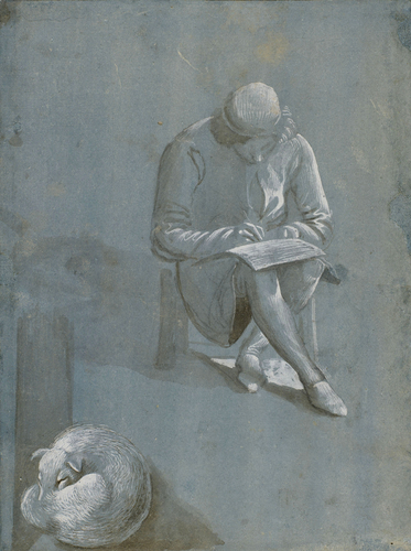 A young man drawing, and a sleeping dog