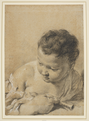The head of a child holding a pipe