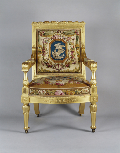 Master: A set of open armchairs