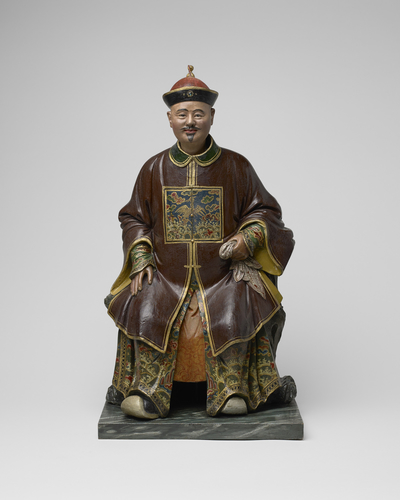 Master: Clay figures of seated Chinese man and woman