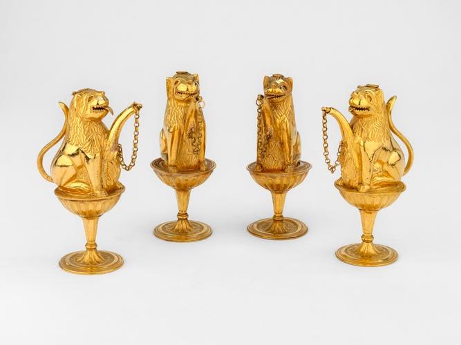 Four perfume holders