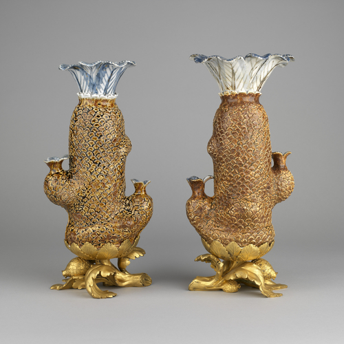 Pair of cycad palm vases with mounts