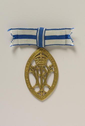 Gold nurse's badge