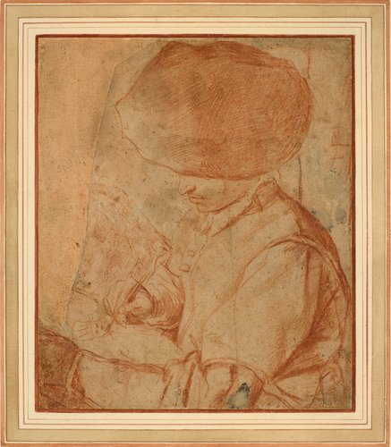 A young man drawing