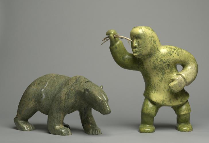 Polar bear and hunter