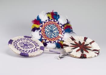 Circular woven raffia fan in green, pink, yellow and purple woven design
