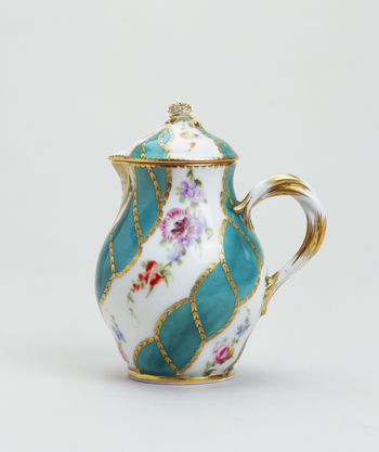 Soft-paste Vincennes/Sèvres porcelain milk jug. White ground with thick spiralling green-ground ribbons alternating with polychrome trails of flowers (roses, convolvulus, narcissi, cornflowers, tulips) applied diagonally and edged with stylised gil