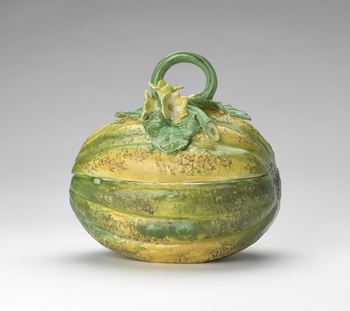 Melon tureen and cover. It has a stalk handle with moulded foliate and flower terminals, and is naturally decorated in green and yellow.<br /><br />In the mid eighteenth century the Chelsea Porcelain Works produced these&nbsp;three-dimensional tureens, in