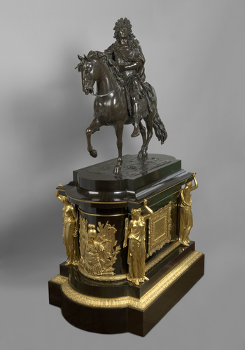 Equestrian statue of Louis XIV in Roman armour, on a rectangular naturalistic base with canted corners. The statue is mounted on an ebony-veneered pedestal with gilt bronze mounts ordered from the firm of Thomire et Cie. in 1826. The sides of the pedestal