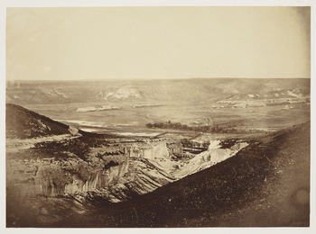 Photograph of the Valley of Inkerman, showing the quarries and aqueduct. The photograph is taken from a high vantage point.  The Battle of Inkerman was fought in this valley in November 1854.