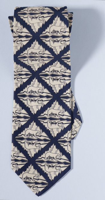 Necktie decorated with polar bears presented to The Duke of Edinburgh by the World Wildlife Fund, navy blue lattice decoration with white images.